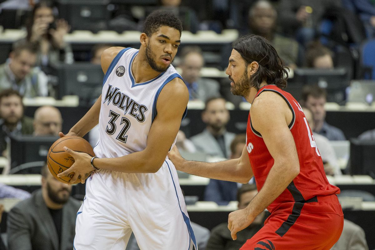 Luis Scola, right, defends Karl-Anthony Towns