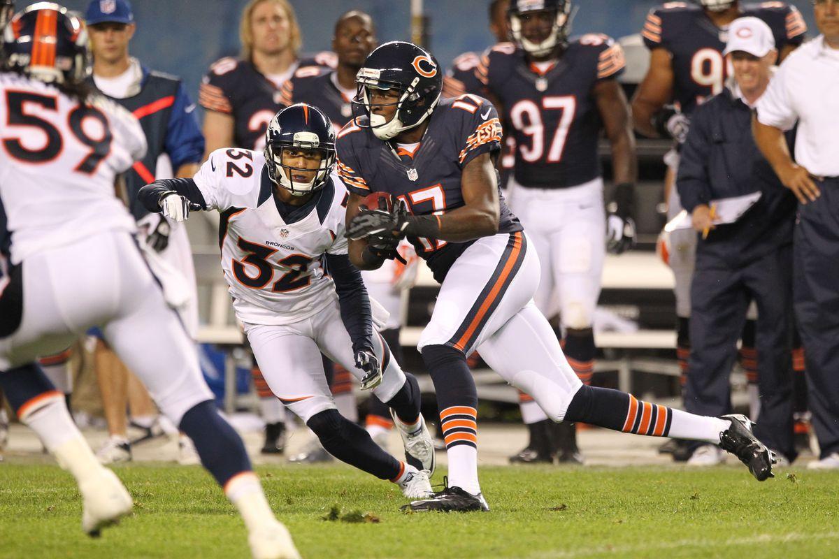 Aug 9, 2012; Chicago, IL, USA; Chicago Bears receiver Alshon Jeffery (17) catches a pass against Denver Broncos cornerback Tony Carter (32) at Soldier Field.  Mandatory Credit: Matthew Emmons-US PRESSWIRE