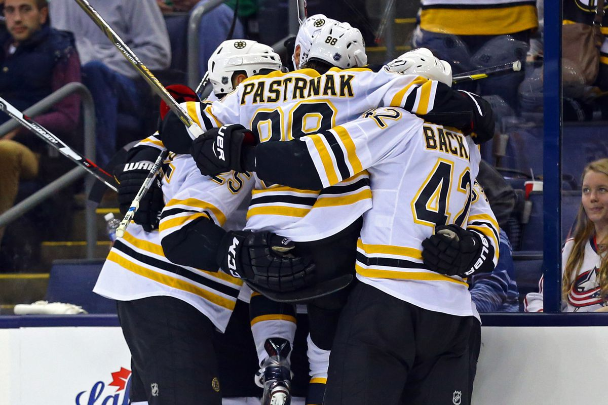 Infectious excitement... (David Pastrnak leaps into his teammates' arms)