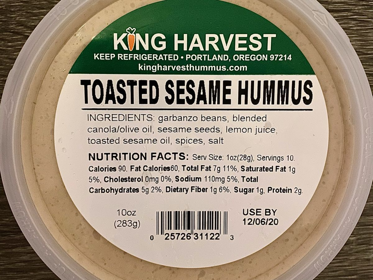 A plastic tub of toasted sesame hummus from King Harvest