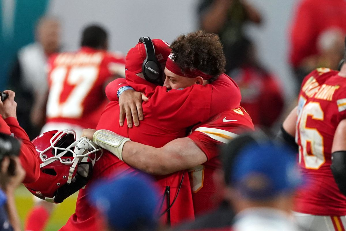 Kansas City Chiefs head coach Andy Reid and quarterback Patrick Mahomes (15) embrace during the end of the fourth quarter against the San Francisco 49ers in Super Bowl LIV at Hard Rock Stadium.