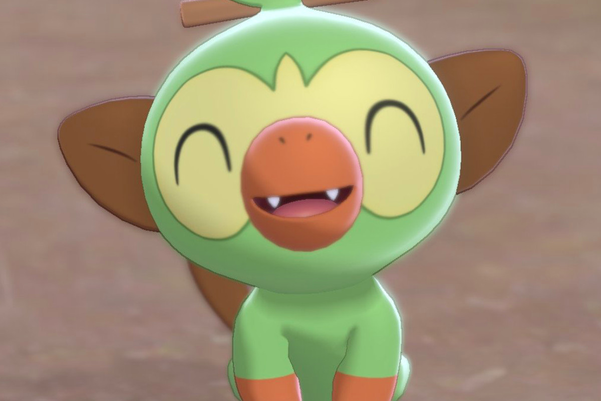 Grookey, one of Sword and Shield's starters, smiles at the camera.