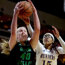 Utah Valley University Wolverines center Sam Lubcke (40) goes for a loose ball against Cal State Bakersfield Roadrunners forward Erika Williams (15) in the 2017 WAC Tournament quarterfinals at Orleans Arena in Las Vegas on Wednesday, March 8, 2017.