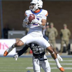 Boise State wide receiver Khalil Shakir (2) catches a pass as Utah State safety Monte' McGary (26) defends during the first half of an NCAA college football game Saturday, Sept. 25, 2021, in Logan, Utah.