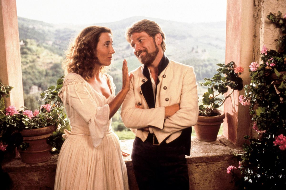 Beatrice (Thompson) and Benedick (Branagh) look fondly at each other.