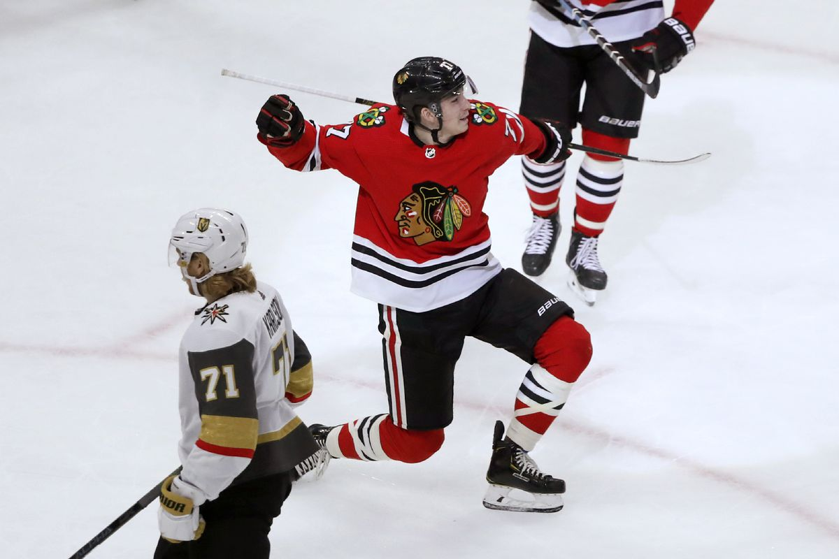 The Blackhawks' Kirby Dach celebrates his first NHL goal as Vegas Golden Knights' William Karlsson skates by during the first period of a hockey game Tuesday, Oct. 22, 2019, in Chicago.