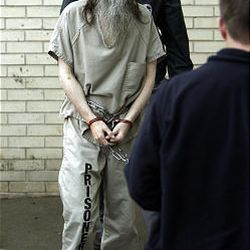 Brian David Mitchell is escorted into court in Salt Lake City Friday.