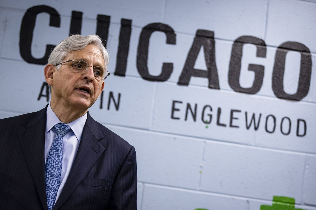 U.S. Attorney General Merrick Garland takes questions from reporters before attending a listening session on reducing gun violence at St. Agatha Catholic Church on July 22, 2021 in Chicago, Illinois.