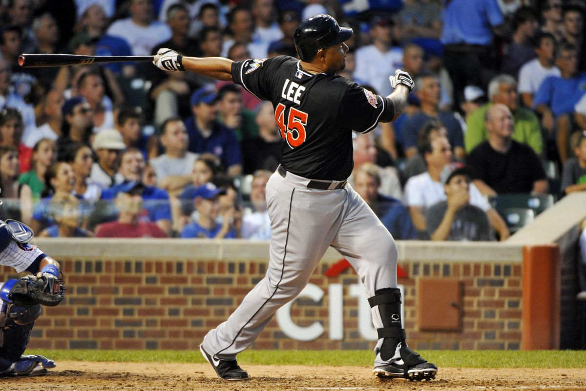 July 17, 2012; Chicago, IL, USA; Miami Marlins player Carlos Lee hits a grand slam home run during the fifth inning against the Chicago Cubs at Wrigley Field.  Mandatory Credit: Rob Grabowski-US PRESSWIRE