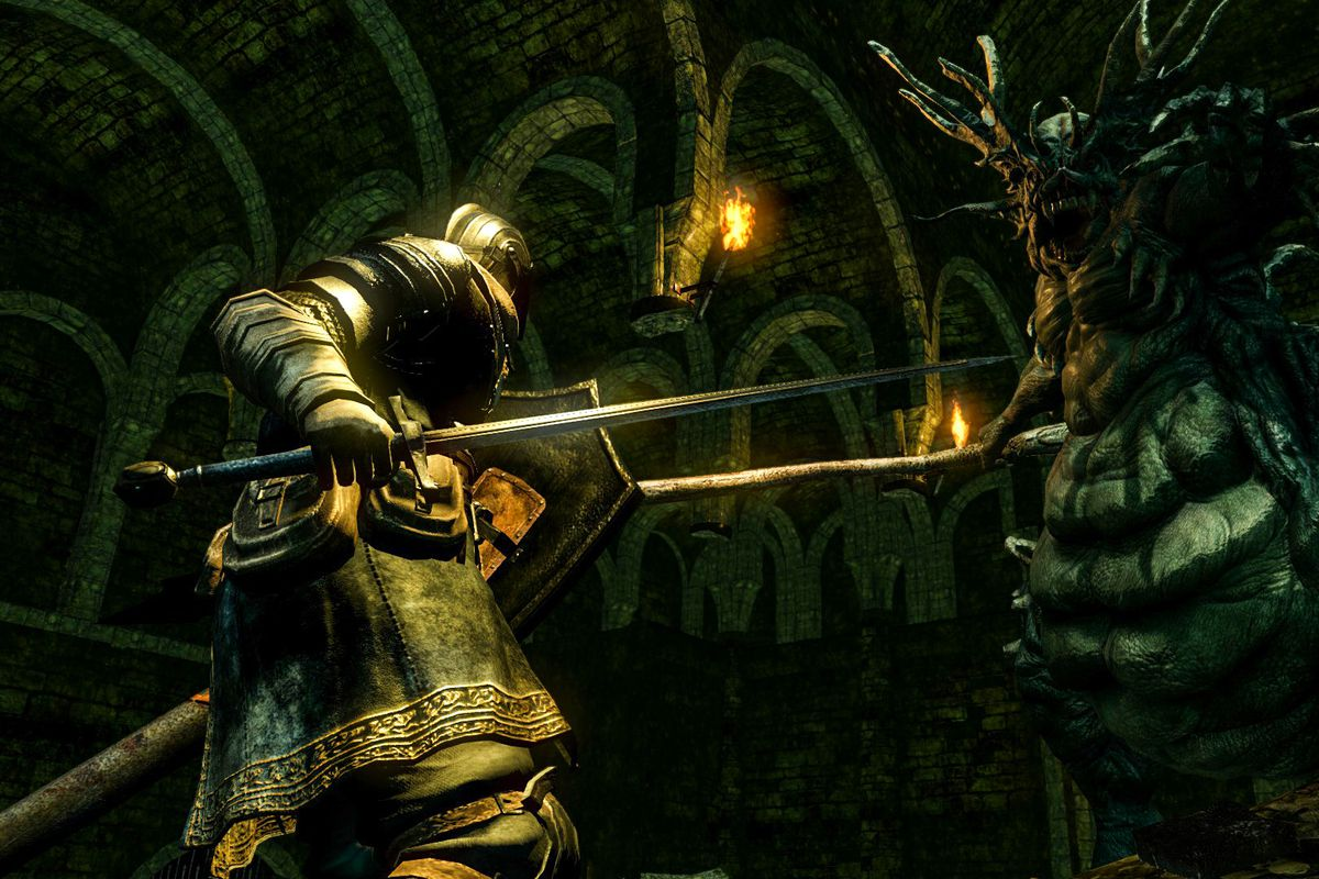 The player fights an insectile monster from Dark Souls