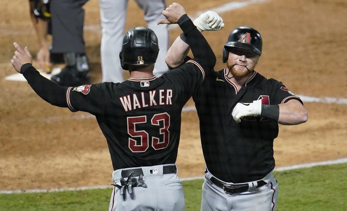 Christian Walker & Kole Calhoun celebrate