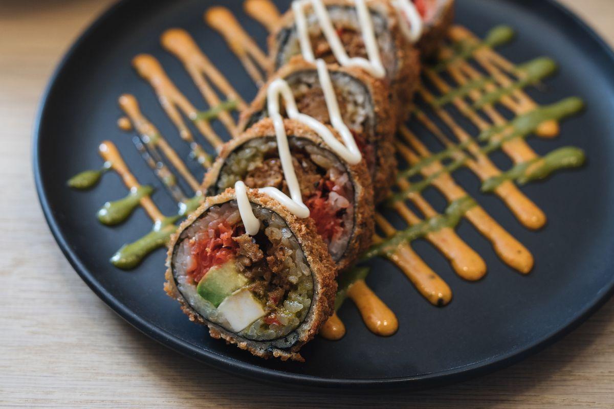Sushi with Beyond Meat, vegan feta, caramelized onion, avocado, and teriyaki-basil sauce.