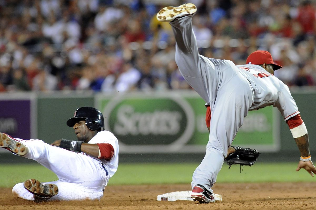 August 21, 2012; Boston, MA, USA; Los Angeles Angels second baseman Howard Kendrick (47) forces out Boston Red Sox second baseman Pedro Ciriaco (77) at second base during the third inning at Fenway Park. Mandatory Credit: Bob DeChiara-US PRESSWIRE