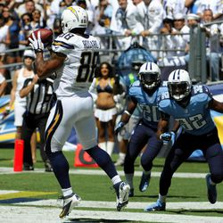San Diego Chargers tight end Dante Rosario makes a touchdown catch in the end zone as Tennessee Titans strong safety Robert Johnson, right, and cornerback Alterraun Verner, center, watch during the first quarter of an NFL football game, Sunday, Sept. 16, 2012, in San Diego.