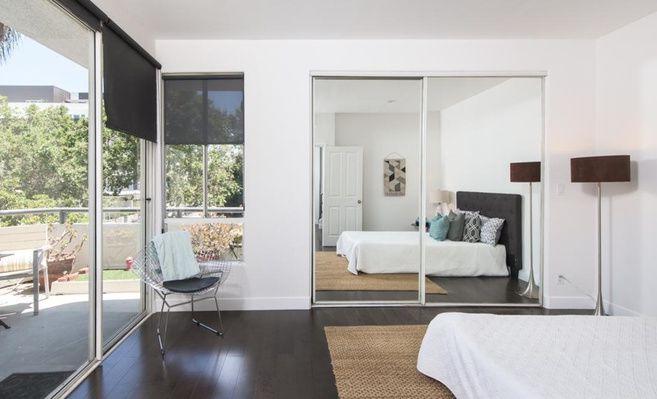 Bedroom with door to balcony