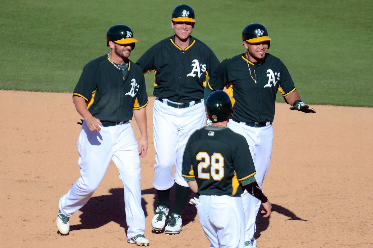 From left: Andy Parrino, Jim Harbaugh, Renato Nunez, and Eric Sogard's back (No. 28)