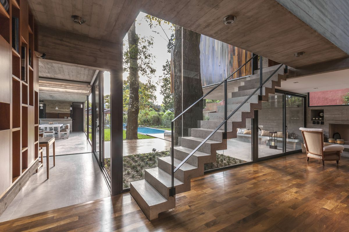 Interior of house with stairs and window looking out onto a pool