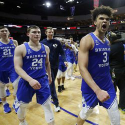 Brigham Young Cougars guard Elijah Bryant, right, celebrates after BYU defeats the St. Mary's Gaels during the West Coast Conference basketball tournament in Las Vegas on Monday, March 5, 2018.