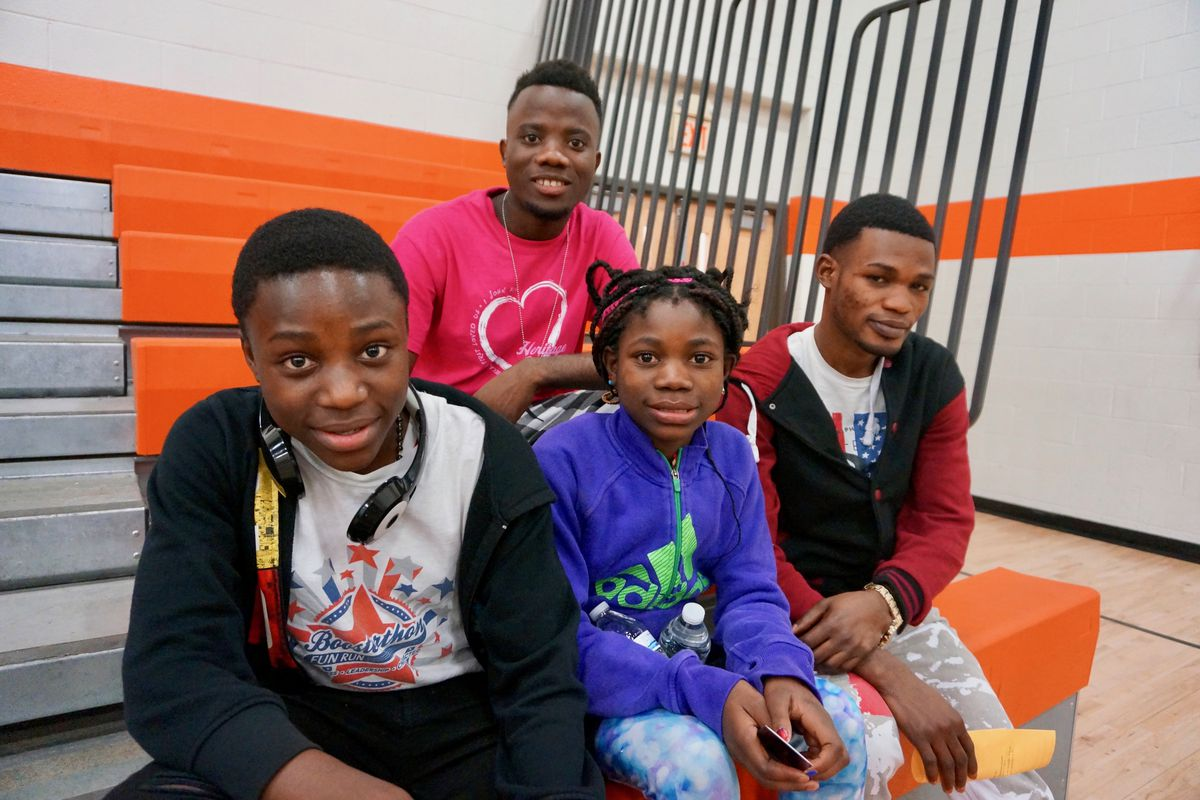 Mbeomo and Tosha Msambilwa with their older brothers. The Msambilwa's are refugees and students at the newcomer school in Indianapolis Public Schools.