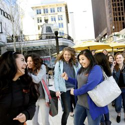 Students of the Academy of Hospitality & Tourism school of Taylorsville High School celebrate the opening of the City Creek  in Salt Lake City on Thursday, March 22, 2012.  The students and their teachers came to study marketing and the economy.