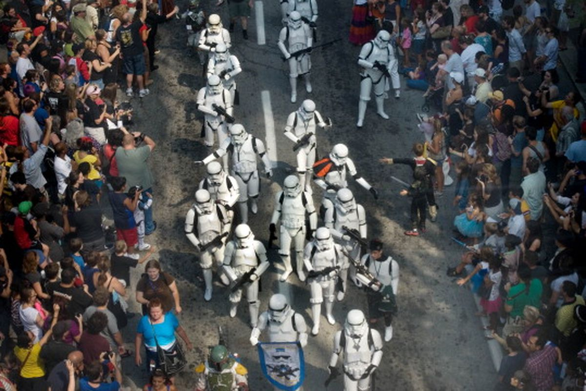 A photo of Star Wars stormtroopers in white marching down a street.