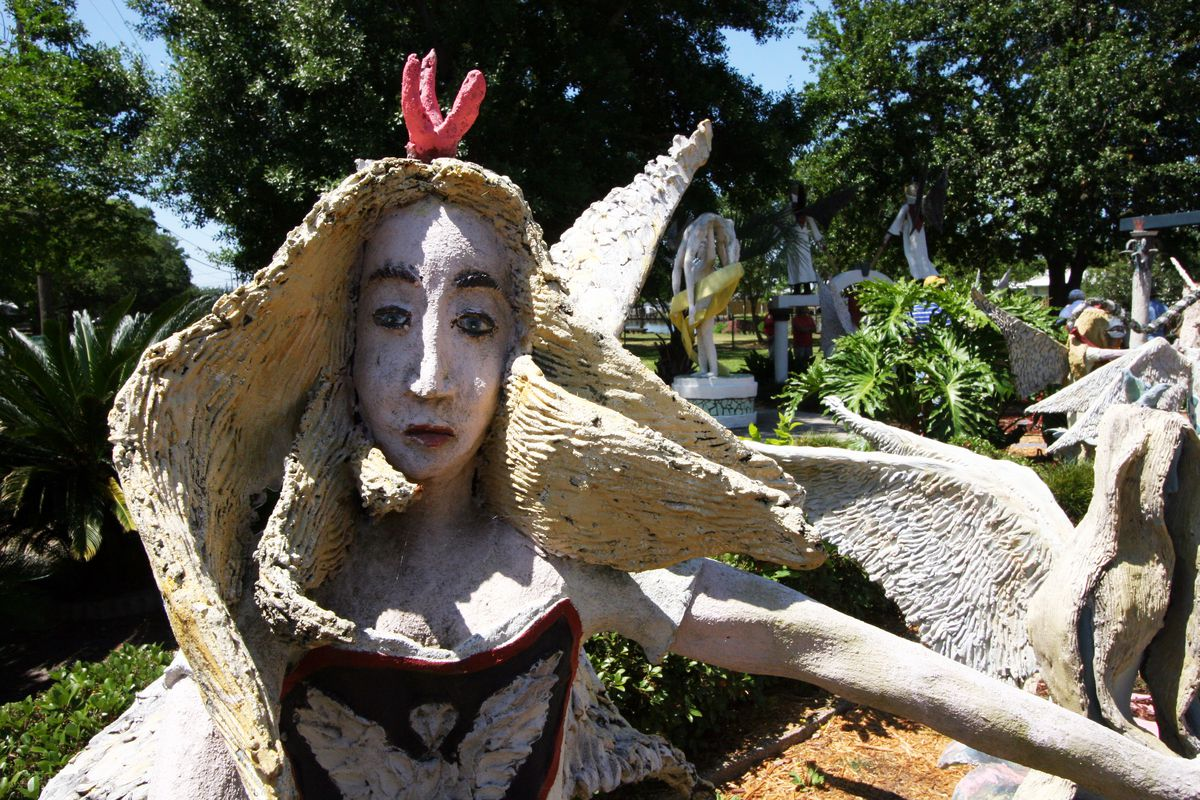 A concrete sculpture of a person at the Kenny Hill Sculpture Garden in Louisiana.