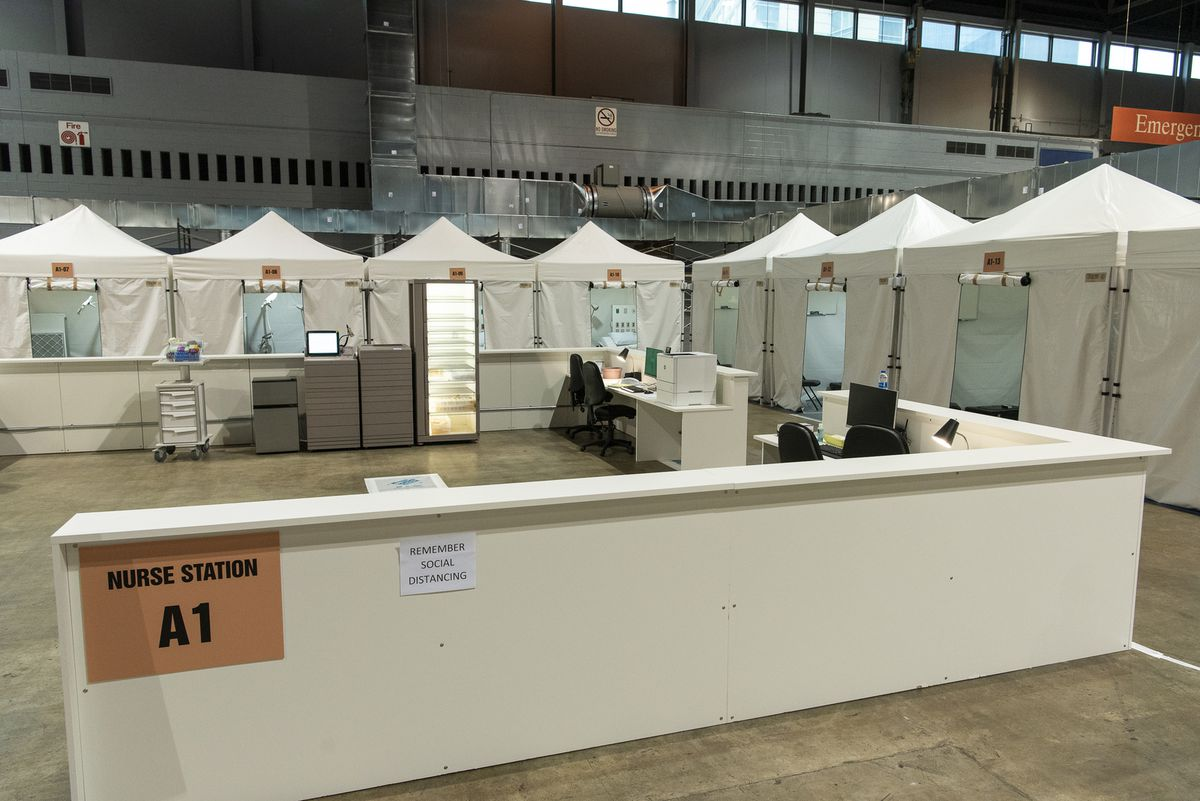 A nurse's station at the new field hospital at McCormick Place is flanked by patient rooms.