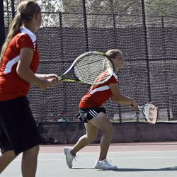 Amanda (left) and Arie Naylor of Manti compete against Katie Panushka and Kelsey Almony of St. Joseph (not pictured) in the State 2A Tennis first seed doubles tournament at Liberty Park in Salt Lake City Saturday, Sept. 29, 2012.