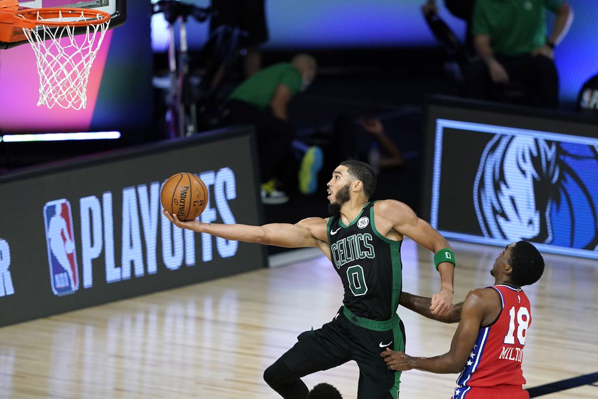 Jayson Tatum of the Boston Celtics drives to the basket against Shake Milton of the Philadelphia 76ers during the second half at The Field House at ESPN Wide World Of Sports Complex on August 17, 2020 in Lake Buena Vista, Florida.