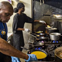 Derrick Cooper [left] and Paul Marlon man the stoves as they cook orders at Home Grown.