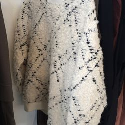Sweater, $180
