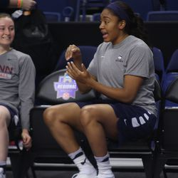 UConn's Tierney Lawlor laughs at something Morgan Tuck is doing.