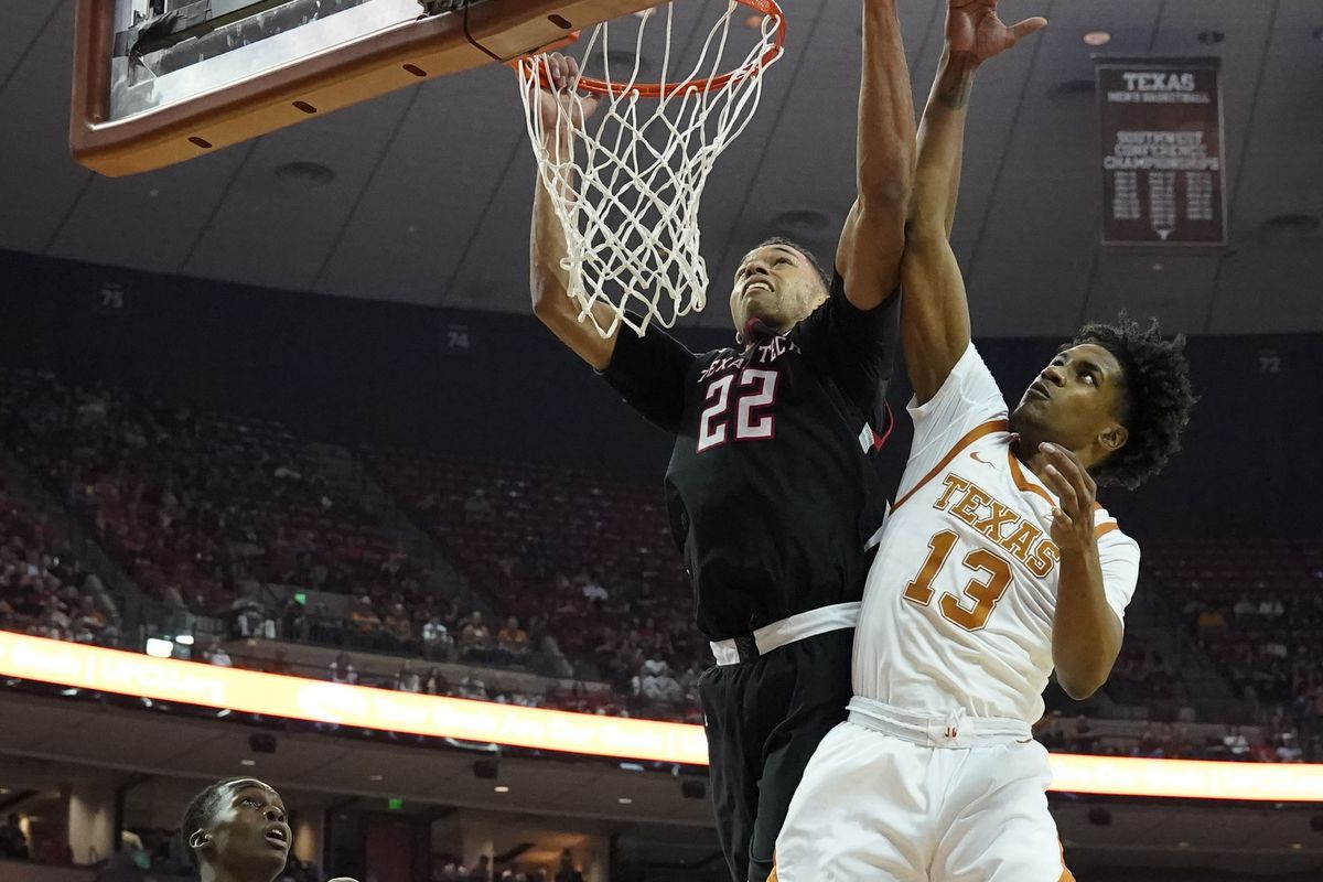 Texas Tech Red Raiders forward TJ Holyfield and Texas Longhorns guard Jase Febres go after a rebound in the second half at Frank C. Erwin Jr. Center.