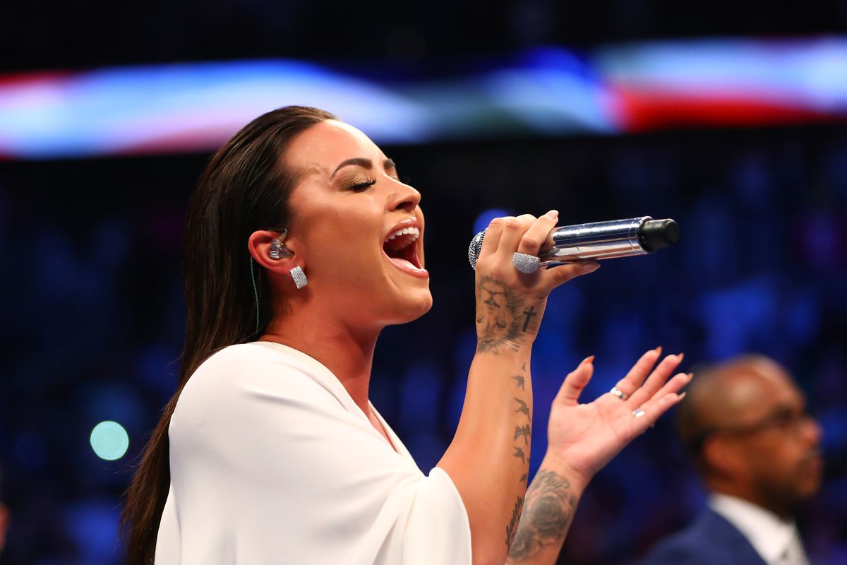 Recording artist Demi Lovato sings the national anthem at T-Mobile Arena.