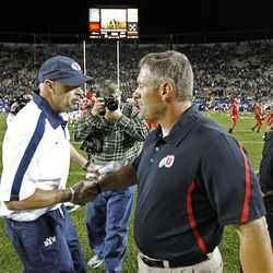 Bronco Mendenhall and Kyle Whittingham shake hands after the University of Utah defeats Brigham Young University 54-10 as they play football Saturday, Sept. 17, 2011, in Provo, Utah.