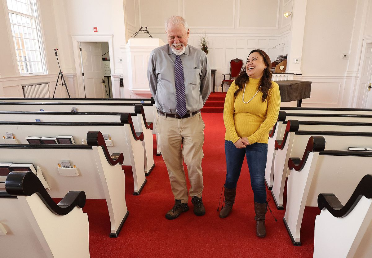 The Rev. Tom Golsmith, left, shares a laugh with Vicky Chavez at the First Unitarian Church of Salt Lake City in Salt Lake City on Wednesday, March 24, 2021. Chavez, who for three years has sought sanctuary with her young daughters at the church, and three other women in similar situations in other states are suing U.S. immigration officials, alleging they are facing steep fines because they spoke out about their cases.