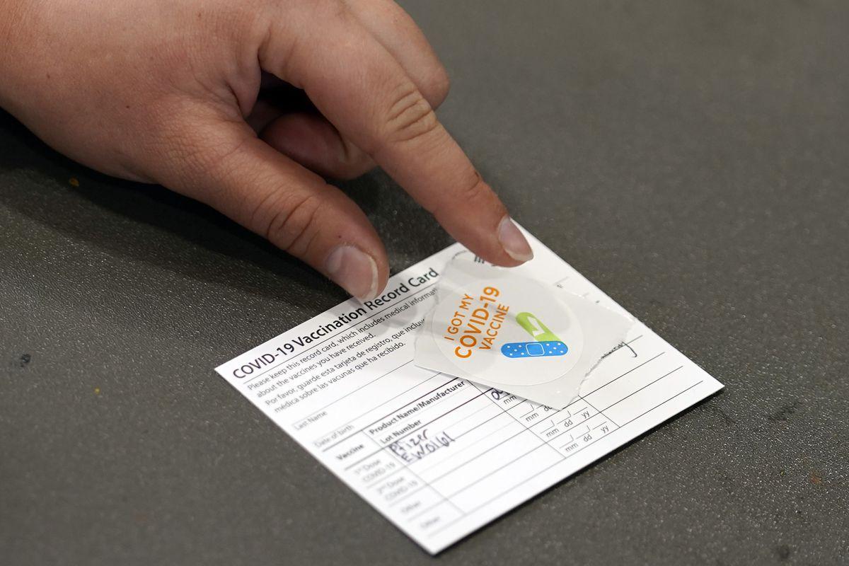 A COVID-19 vaccination card in Wilmington, California.