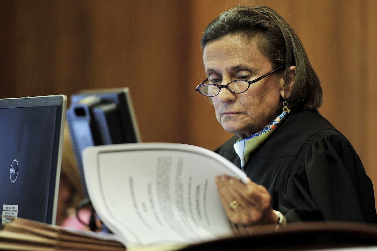 Chancellor Claudia Bonnyman looks over evidence during a 2015 trial. The Nashville judge is presiding over a school funding lawsuit that pits Tennessee's two largest districts against the state.