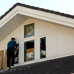 The stained glass windows of an LDS hurch on McClelland in Salt Lake City are boarded up on Nov. 8, 2006.