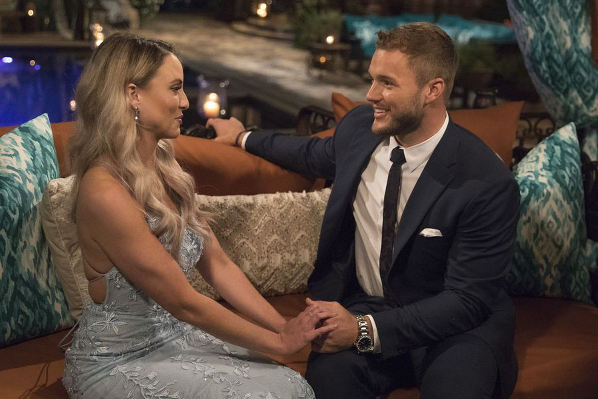 Colton sitting with a 'Bachelor' contestant