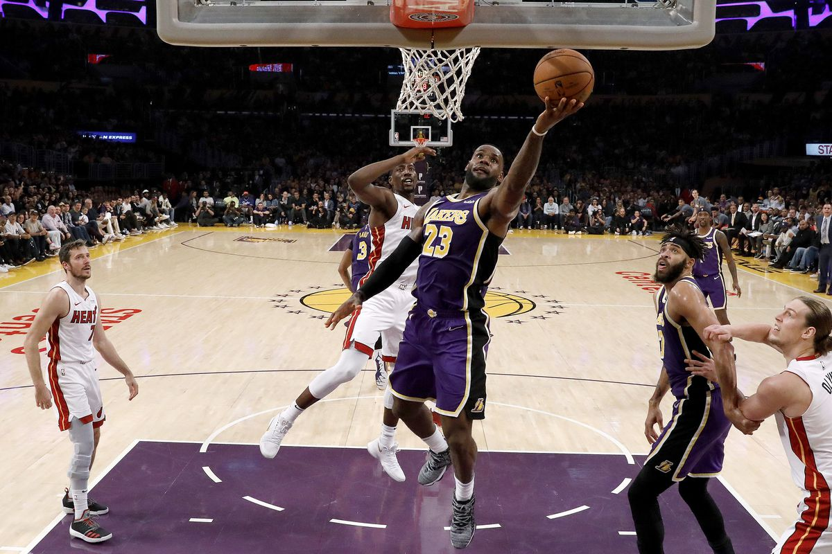 LeBron James of the Los Angeles Lakers drives past Bam Adebayo of the Miami Heat during the second half of a game at Staples Center on November 08, 2019 in Los Angeles, California.