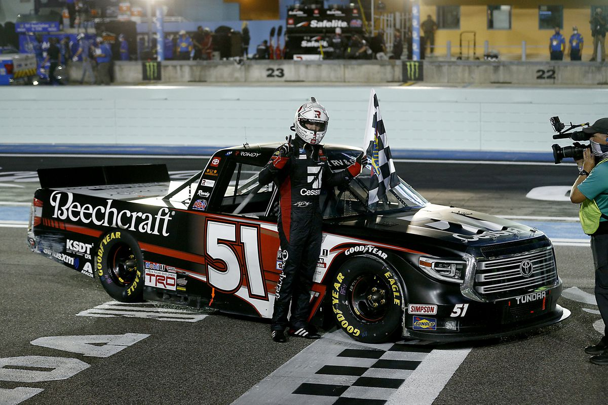 Kyle Busch, driver of the #51 Cessna Toyota, celebrates with the checkered flag after winning the NASCAR Gander RV & Outdoors Truck Series Baptist Health 200 at Homestead-Miami Speedway on June 13, 2020 in Homestead, Florida.