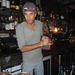 """Andy Boose, the owner of Interstate Food & Liquor on Orchard Street, had plenty of ice, liquor, cold beer on tap, and an old fashioned crank radio. Note the swanky headlamp. [Photo: <a href=""""http://www.thelodownny.com/2012/10/lower-east-side-bar-crawl-pos"""