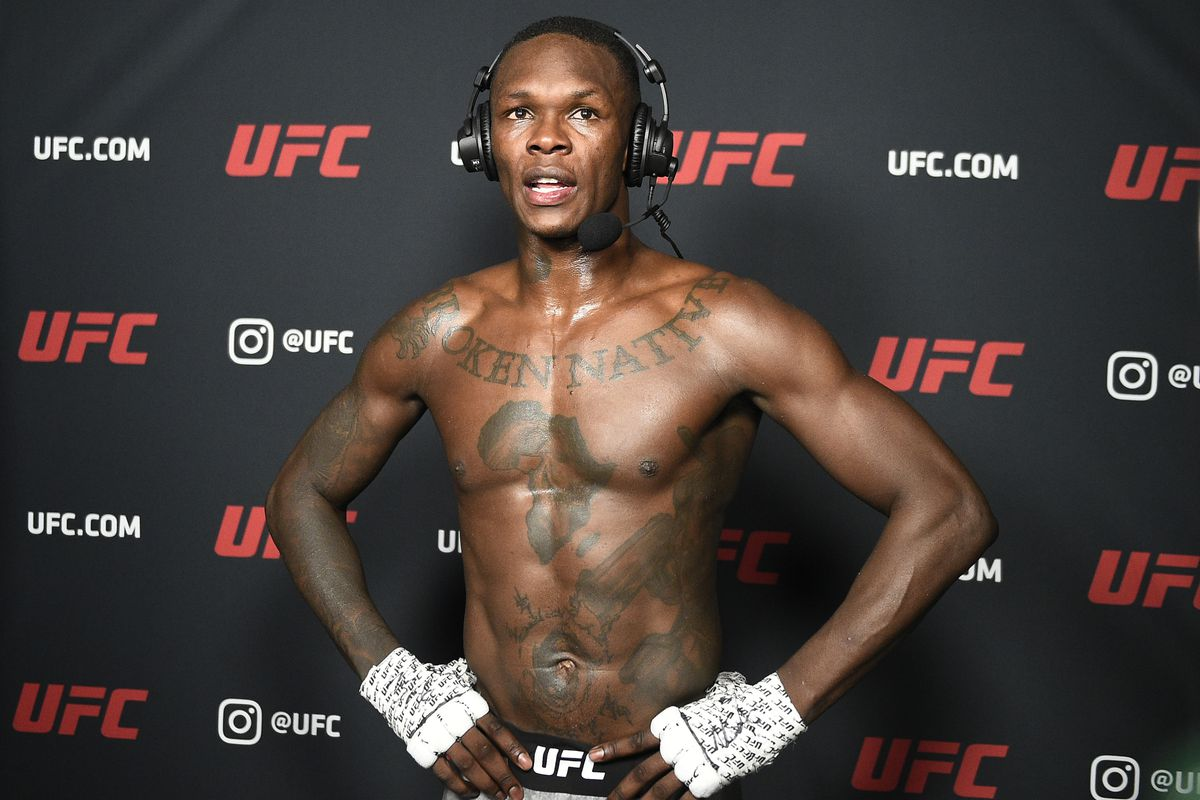 Israel Adesanya of Nigeria is interviewed after his UFC light heavyweight championship fight against Jan Blachowicz of Poland during the UFC 259 event at UFC APEX on March 06, 2021 in Las Vegas, Nevada.