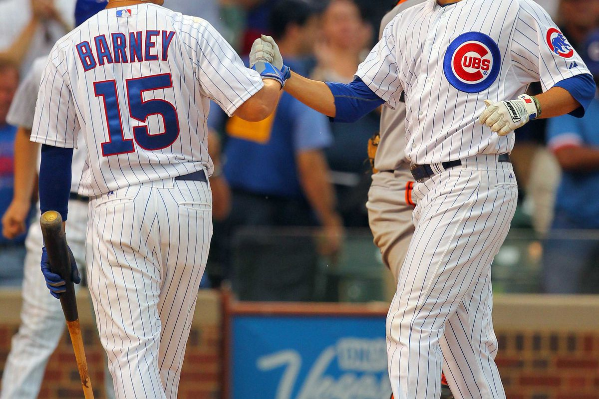 Chicago, IL, USA; Chicago Cubs right fielder David DeJesus is congratulated for hitting a two-run home run by second baseman Darwin Barney at Wrigley Field. Credit: Dennis Wierzbicki-US PRESSWIRE