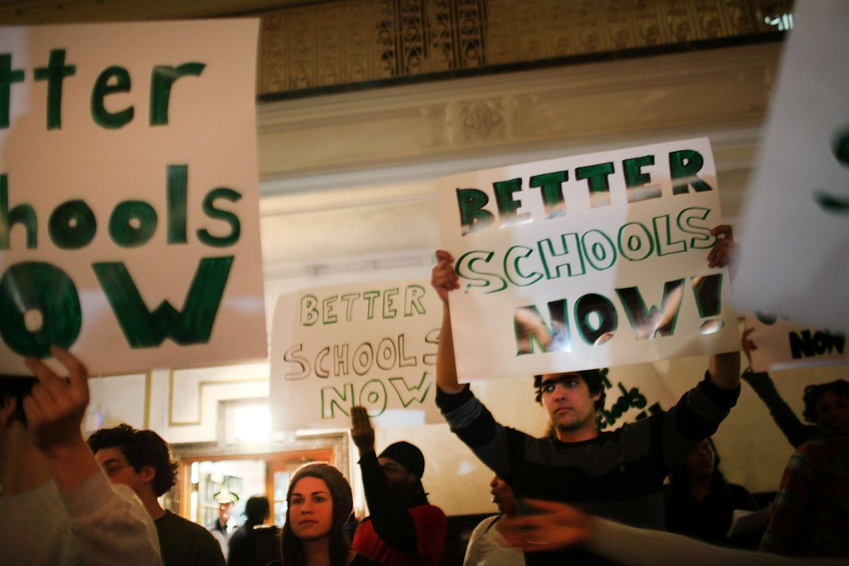 People protest during a Panel for Educational Policy meeting at Brooklyn Tech High School before they vote on whether to close or partially close 23 schools that the Department of Education considers failing on February 9, 2012 in New York City. (Photo by Spencer Platt/Getty Images)