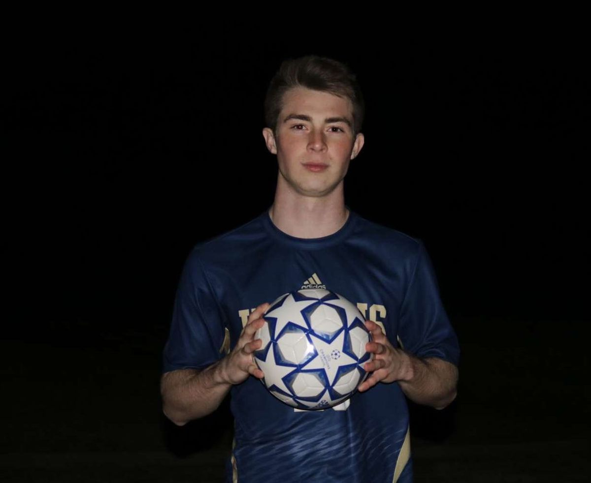 Britton Majure with a soccer ball.