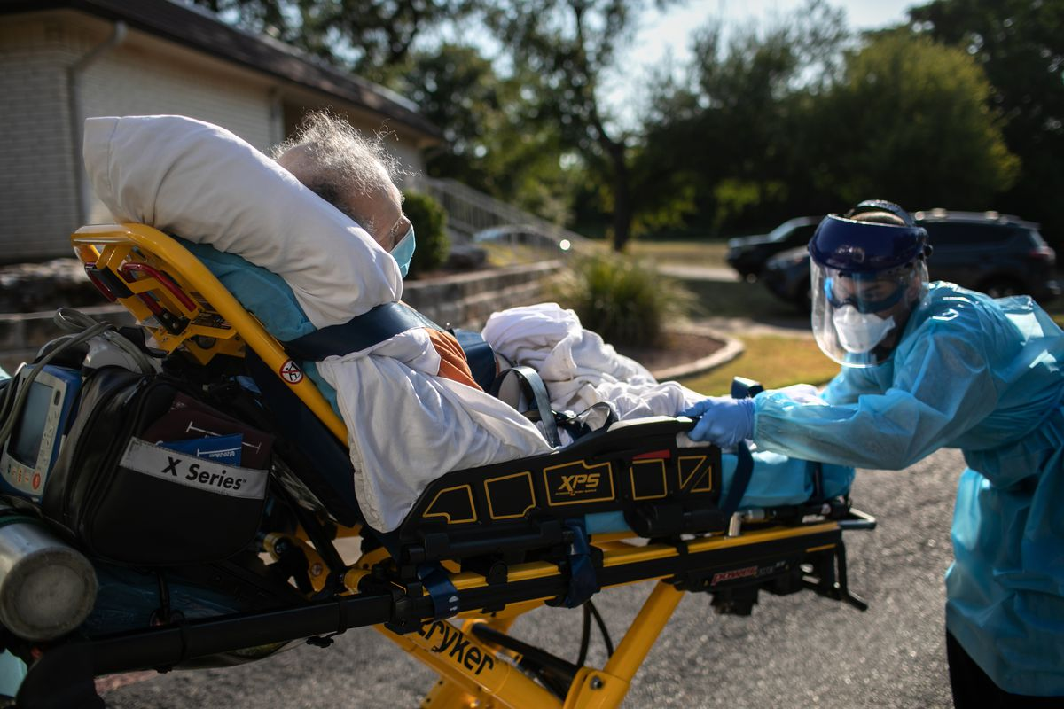 An Austin-Travis County medic loads a patient with COVID-19 symptoms into an ambulance on August 05, 2020 in Austin, Texas.