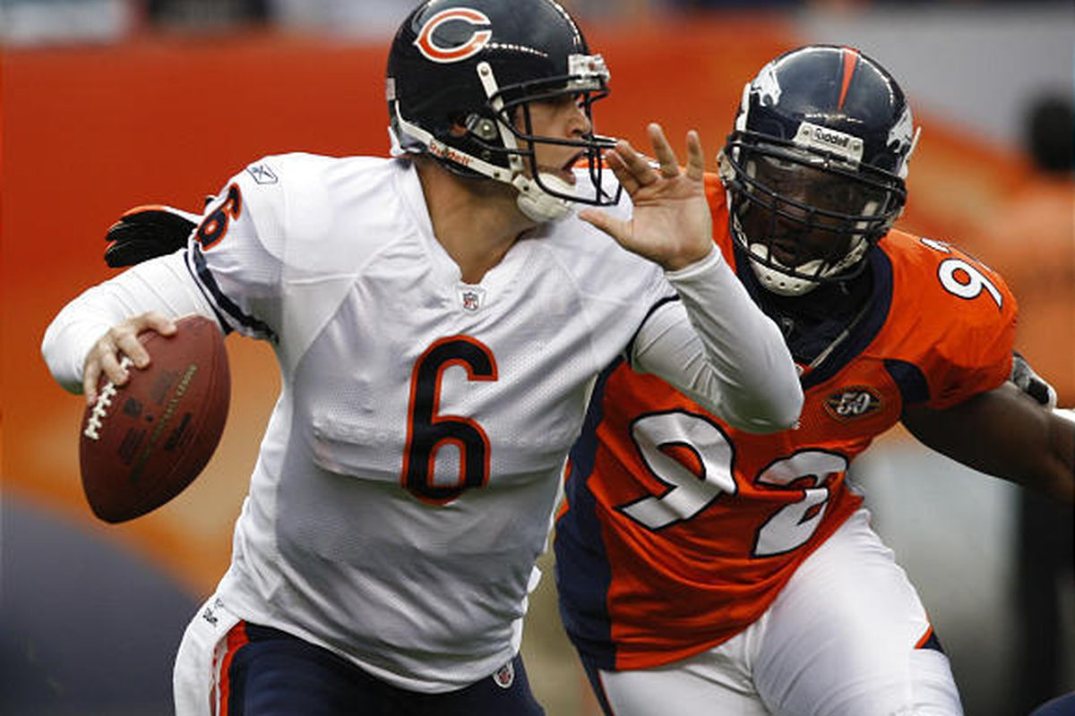 Chicago Bears quarterback Jay Cutler (6) scrambles out of the pocket to avoid the rush of Denver Broncos Elvis Dumervil (92) during the first quarter of a NFL preseason football game in Denver on Sunday.