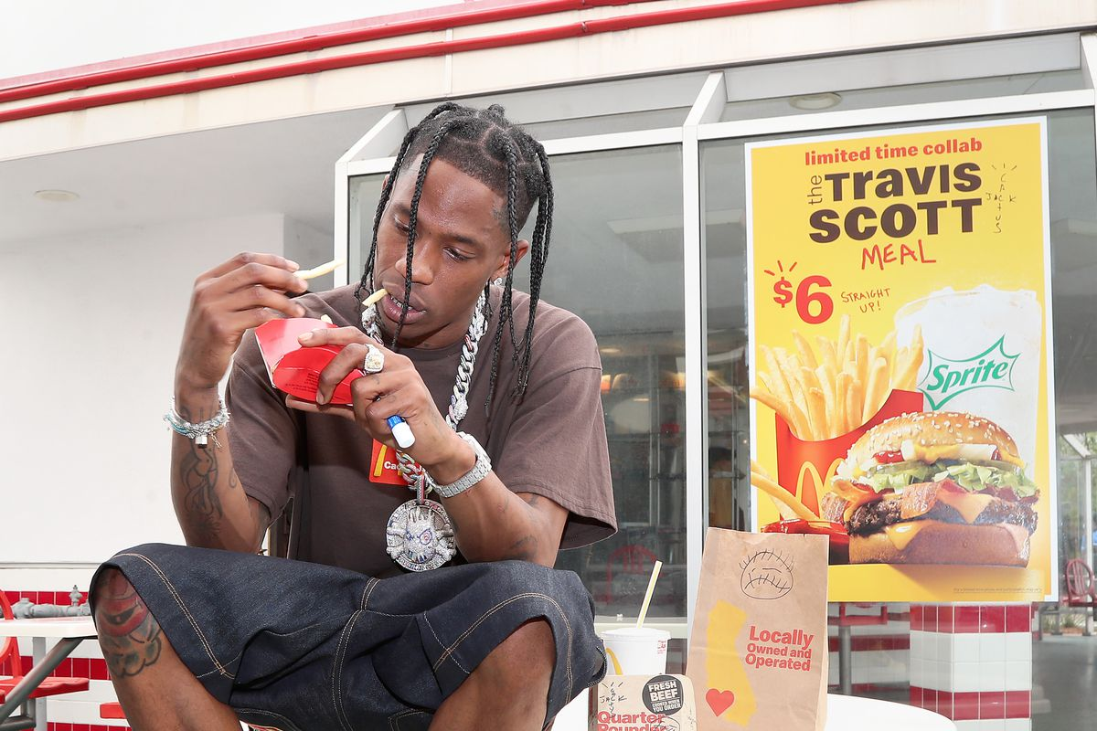 Travis Scott surprises crew and customers at McDonald's for the launch of the Travis Scott Meal earlier this month in Downey, California.